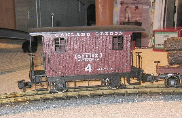 Bachmann g scale undec lumber caboose i have added custom decals from stan cedarleaf to make this caboose part of the oakland oregon lumber co